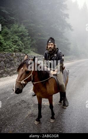 8th August 1993 During the war in Bosnia: a bearded Bosnian-Serb soldier sits astride his horse on Mount Trebevic, on the road between Pale and Sarajevo. - Stock Photo