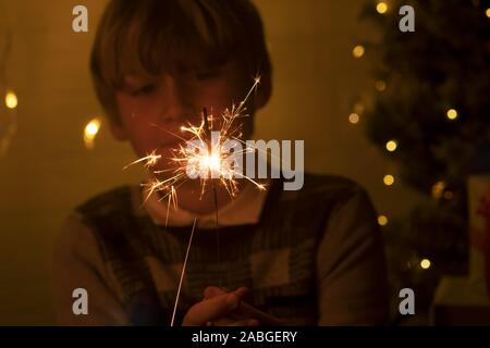 Bengal fire and sparks macro photo festive bokeh background Christmas and New Year - Stock Photo