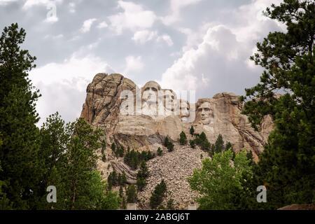 Four presidents heads carved into the rock at Mount Rushmore South Dakota in a summer landscape - Stock Photo