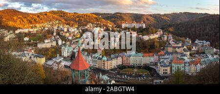 View to Karlovy Vary city from above at sunset - Stock Photo