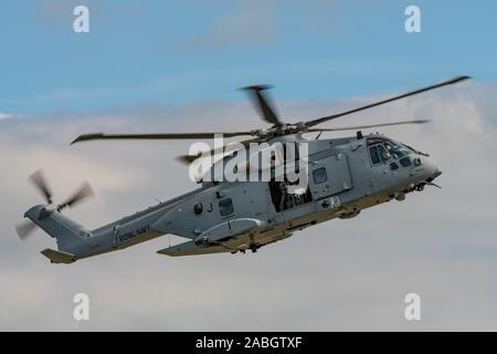 The Royal Navy Merlin HC4 helicopter took part in the commando assault demonstration at the RNAS Yeovilton Air Day, UK held on the 13th July 2019. - Stock Photo