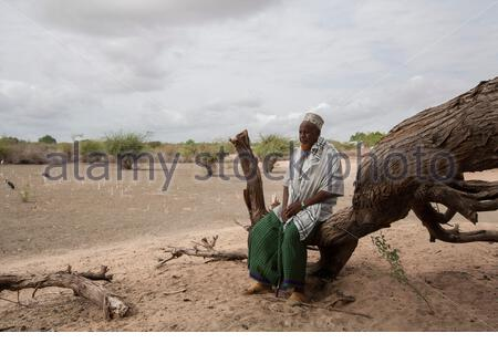 Kenya - Dadaab - 24th July 2011. Mohammed Ahmed Shuria, 60 years old, sitting in his field inside Hagadera refugee camp where he arrived in 1991, when the war started in Somalia. Due to the drought his field has been unproductive for the past 2 years. Bef - Stock Photo