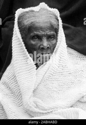 Vintage portrait photo of Harriet Tubman (c1820 – 1913). Born into slavery, Tubman (birth name Araminta Ross) escaped and later guided other slaves to freedom via the Underground Railroad before working as a nurse, spy and scout for the Union Army during the American Civil War. In later life she engaged in humanitarian work and promoted the cause of women's suffrage. Photo circa 1911, likely taken at Tubman's home in Auburn, New York. - Stock Photo
