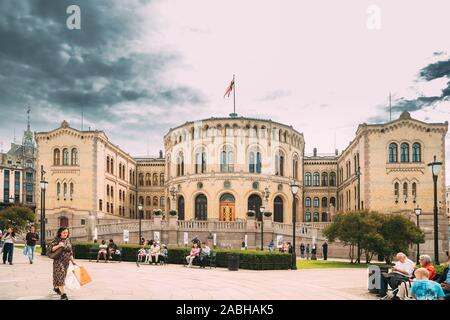 Oslo, Norway - June 24, 2019: People Walking Near Oslo Parliament. Storting building or Stortingsbygningen. Famous And Popular Place. - Stock Photo