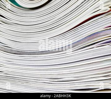 Magazine stacked up end on view - Stock Photo