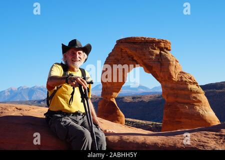 A senior hiker enjoying the views from the Delicate Arch area of Arches National Park. - Stock Photo