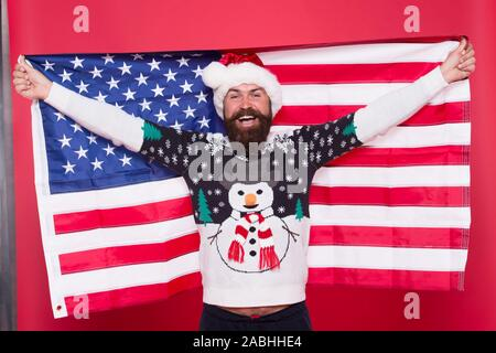 Merry american xmas. Happy Santa hold american flag. Bearded man celebrate xmas. Holiday decoration and decor. All american xmas party. Happy new year. Its xmas time. - Stock Photo
