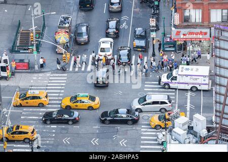 color image View from sky on the streets of New York City. Top view on the street with cars and people on the crossroad in NYC manhattan - Stock Photo