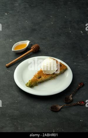 turkish kunefe with ice cream on the table - Stock Photo