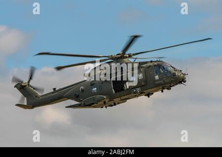 The Royal Navy Merlin HC3 helicopter took part in the commando assault demonstration at the RNAS Yeovilton Air Day, UK held on the 13th July 2019. - Stock Photo
