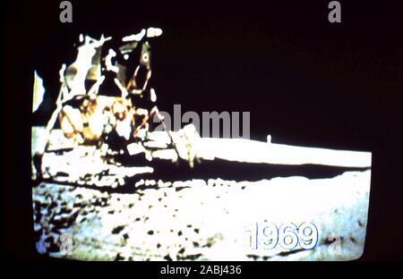Teleclip - Apollo 11 Buzz Aldrin stepping down onto the Moon's surface the second man on the Moon – shot by Neil Armstrong - photo taken directly from TV screen circa 1969/72 - Stock Photo