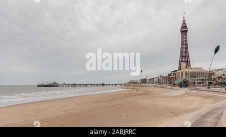 Blackpool, England, UK - April 28, 2019: View from the beach towards the Blackpool Tower and the North Pier - Stock Photo