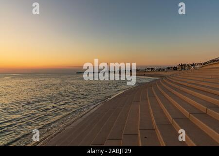 Blackpool, England, UK - April 29, 2019: Evening light over Blackpool, seen from the South Pier, looking north towards Central Pier and the Tower - Stock Photo