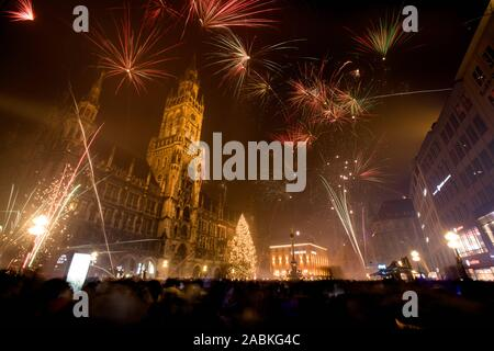Fireworks in front of the town hall at Munich's Marienplatz. [automated translation] - Stock Photo
