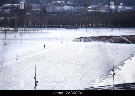 Snow-covered English Garden in Munich. [automated translation] - Stock Photo