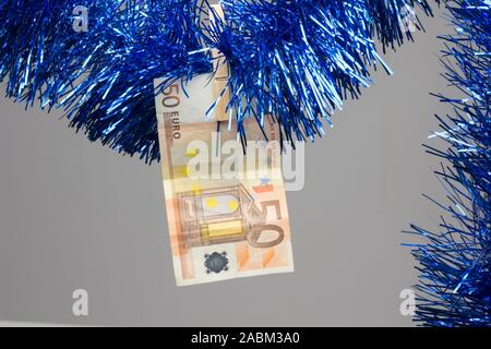 Money and gifts are linked to Christmas, food, desserts, decoration, clothing, shoes, toys must be bought and therefore must be paid with money. - Stock Photo