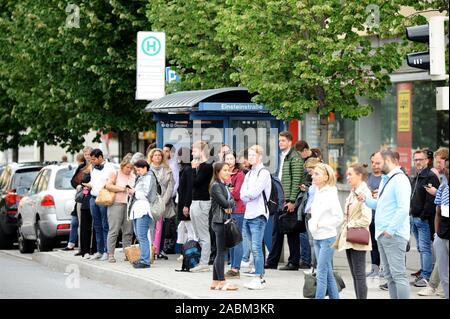 Eleven-hour warning strike of the trade union Verdi in public transport in Munich. Affected are subways, buses and trams of the Münchner Verkehrsgesellschaft (MVG). Passengers waiting in the picture at a tram stop in Einsteinstraße. [automated translation] - Stock Photo