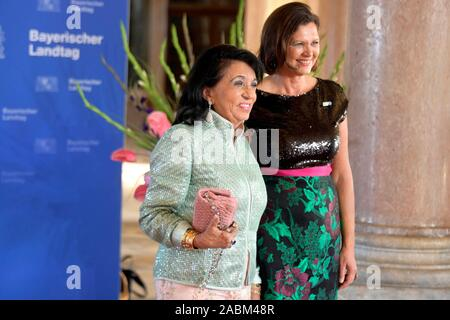 Festive guests at the festive summer reception of the Bavarian Parliament in the New Schleißheim Palace. The picture shows entrepreneur Regine Sixt and state parliament president Ilse Aigner. [automated translation] - Stock Photo