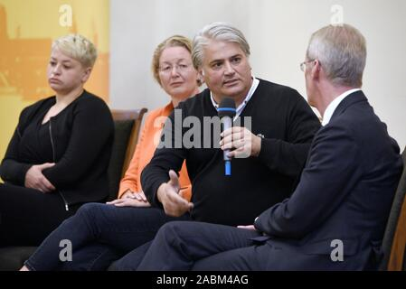 Discussion event at the Munich City Hall on the topic of 'Right-wing terror and the failure of the state' on the first anniversary of the pronouncement of judgement in the NSU proceedings. The picture shows the discussants from the left: Caro Keller (NSU-watch), Annette Ramelsberger (Süddeutsche Zeitung), Mehmet Daimagüler (representative in the NSU trial) and Clemens Binninger (former chairman of the NSU investigative committee in the German Bundestag). [automated translation] - Stock Photo