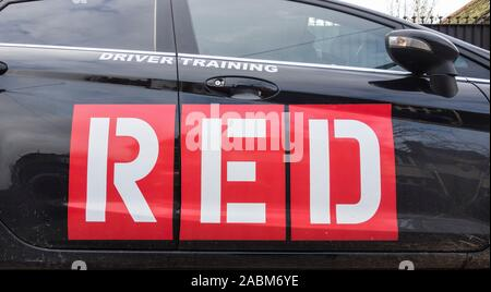 Red School of Motoring signage - Stock Photo