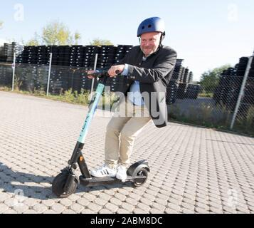 City councillor Christian Vorländer on an electric pedal scooter on TIER's premises in Garching. [automated translation] - Stock Photo