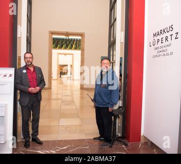 Ai Weiwei (l.) at a protest by the works council at Haus der Kunst against the planned staff reduction by outsourcing the areas of supervision, cash register and gate. In the picture, the Chinese artist tears off admission tickets at the entrance to the Markus Lüppertz exhibition and thus sold himself out with the employees of the house who are threatened with dismissal. [automated translation] - Stock Photo