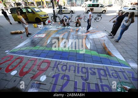 A large-format chalk art picture advertises the Munich Freedom for the worldwide 'Fridays for Future' climate protection demonstration on 20.9.2019 on Odeonsplatz. [automated translation] - Stock Photo