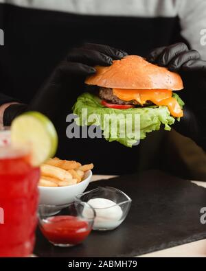 cheeseburger served with french fries - Stock Photo