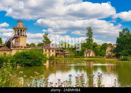 Beautiful panoramic landscape view of the Marlborough Tower, the Queen's House, the boudoir and the mill from the lake in the Queen's Hamlet at the... - Stock Photo