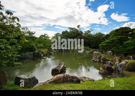 Traditional Japanese gardens and pond near Ni no Maru on the grounds of Nijo Castle in Kyoto, Japan. - Stock Photo