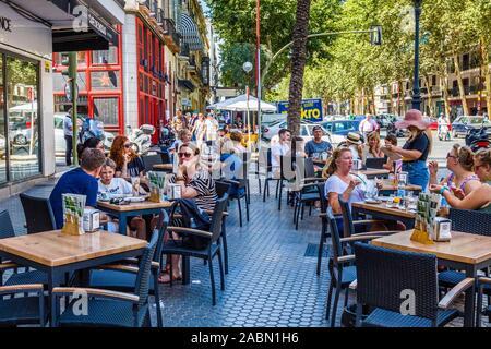 People enjoying outdoor sidewalk cafes in Seville Andulsia Spain