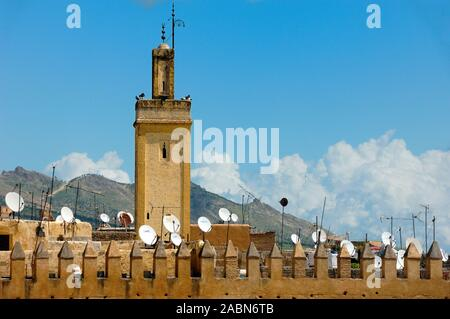 Minaret & Satellite Dishes on Rooftops of the Old Town or Old City of Fez or Fes Morocco - Stock Photo