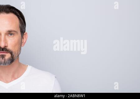 Cropped closeup photo of macho mature guy hide half face perfect neat beard looking indifferent relaxed mind metrosexual wear white t-shirt isolated - Stock Photo