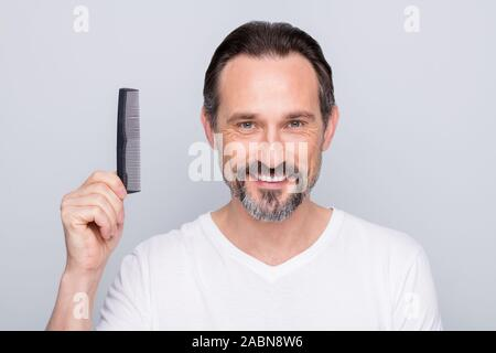 Closeup photo of macho mature guy metrosexual holding new hairbrush advising buyers try amazing quality product wear white t-shirt isolated grey color - Stock Photo