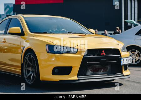 KYIV-28 JULY,2019: JDM car show outdoor.Tuned Japanese drift cars expo in summer.Modified Mitsubishi Lancer Evolution X vehicle with lowered suspensio - Stock Photo