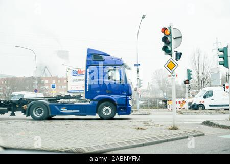 Strasbourg, France - Dec 21, 2016: Defocused view of blue truck driving near the PAS Port of Strasbourg - Stock Photo