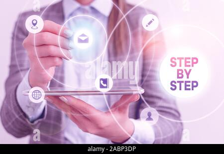 Writing note showing Step By Step. Business concept for Slow progress Road to success Direction development Growth - Stock Photo