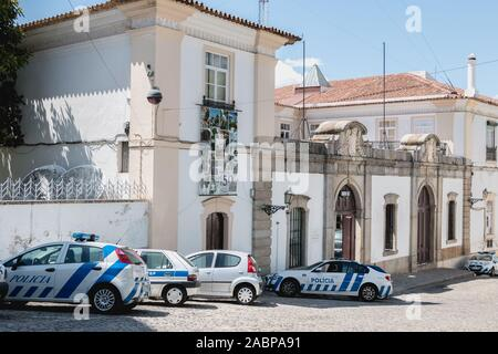 Evora, Portugal - May 5, 2018: view of the small police station neighborhood next to the cathedral basilica Our Lady of the Assumption of Evora a spri - Stock Photo