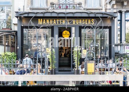 Brussels/ Belgium - 07 03 2019: Art nouveau decorated facade of the restaurant Manhattan's Burgers - Stock Photo
