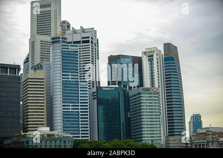 Singapore. June 02, 2018: Singapore business district, skyscrapers viewed from below towards sky represents urban development with modern architecture - Stock Photo