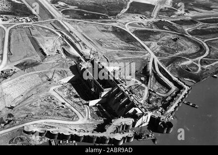 Aerial photo of the construction at Barkley Dam in Kuttawa, Ky., taken Nov. 12, 1963.  The U.S. Army Corps of Engineers Nashville District managed this construction project on the Cumberland River at mile 30.6. The Nashville District invites the public to attend the 50th Year Anniversary commemoration 11 a.m. Aug. 20, 2016 at the Spillway Shelter below the dam. The project is named after the late Alben W. Barkley, attorney, county judge, United States senator, and 35th vice president of the United States. - Stock Photo