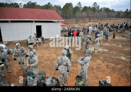 U.S. soldiers assigned to Charlie Company, 1st Battalion, 325th Airborne Infantry Regiment, 2nd Brigade Combat Team, 82nd Airborne Division assist with security during a noncombatant evacuation and repatriation operations exercise during Joint Operational Access Exercise (JOAX) 13-02 Feb. 28, 2013, at a live-fire village near Fort Bragg, N.C. JOAX is designed to enhance cohesiveness between U.S. Army, Air Force and allied personnel, allowing the services an opportunity to properly execute large-scale heavy equipment and troop movement - Stock Photo