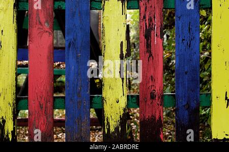 Colorful blue yellow green and red daycare center fence in vrchlabi Czech Republic - Stock Photo