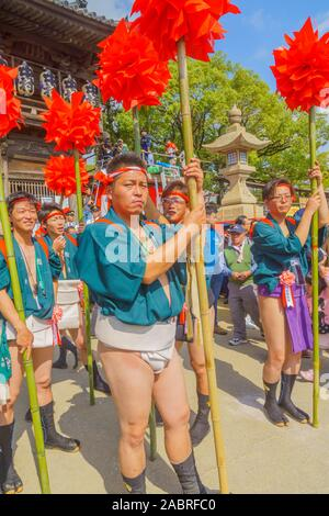 Himeji, Japan - October 14, 2019: Men in traditional dressing take part in the Nada no Kenka Festival, in Himeji, Japan - Stock Photo