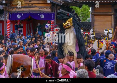 Himeji, Japan - October 15, 2019: Traditional dance of hair lion ceremony (shishimai), performed by several villages groups. Part of the autumn festiv - Stock Photo