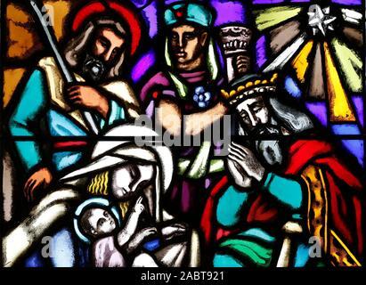Saint Joseph church.  The nativity of Jesus in Bethlehem. Adoration of the Kings. Stained glass window.  Geneva. Switzerland. - Stock Photo