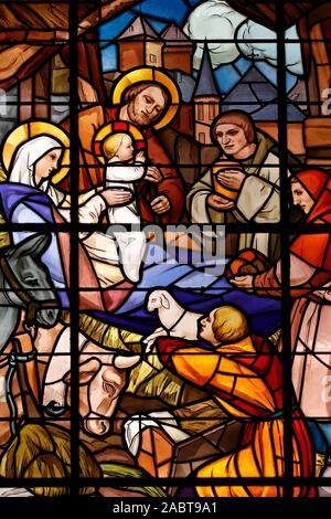 Notre Dame de Liesse church.  The nativity of Jesus in Bethlehem. Stained glass window.  Annecy. France. - Stock Photo