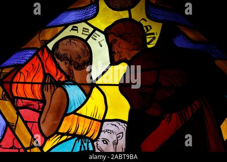 Saint Joseph des Fins church. Abel and Cain.  Stained glass window.  Annecy. France. - Stock Photo