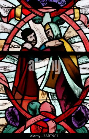 Saint Joseph des Fins church. Jacob and Esau. Stained glass window.  Annecy. France. - Stock Photo