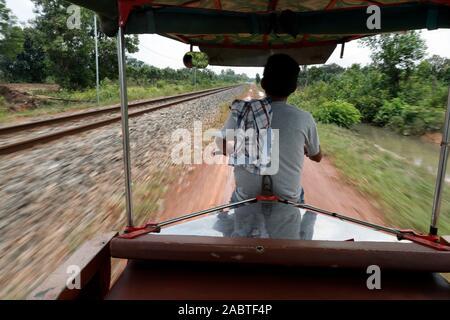 Tuk tuk driver and railway track.  Kep. Cambodia.